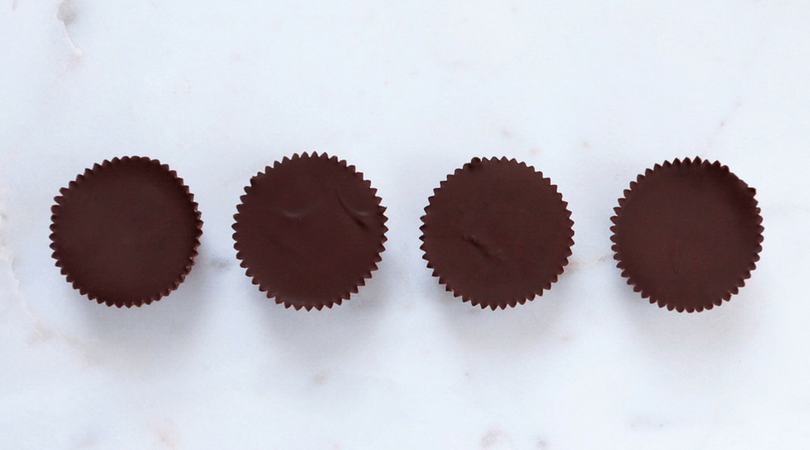 Low FODMAP Chocolate Peanut Butter Cups on Countertop