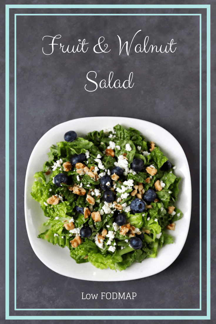 Low FODMAP Fruit and Walnut Salad on plate with text overlay: Fruit and Walnut Salad, Low FODMAP