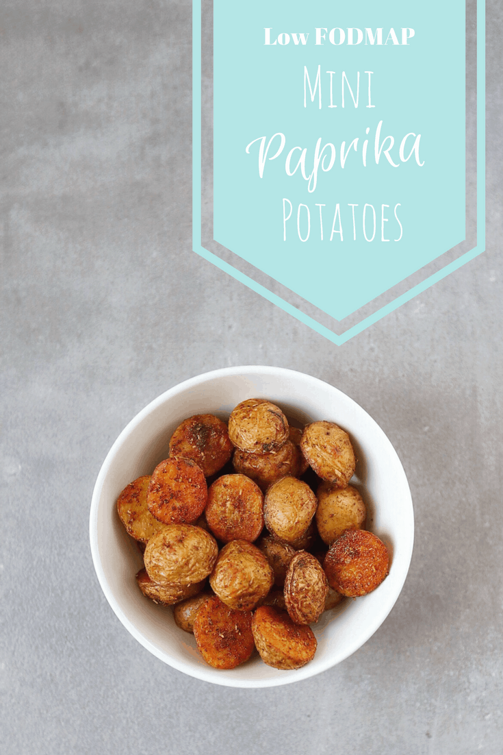 Low FODMAP Mini Paprika Potatoes in bowl with text overlay: Low FODMAP Mini Paprika Potatoes