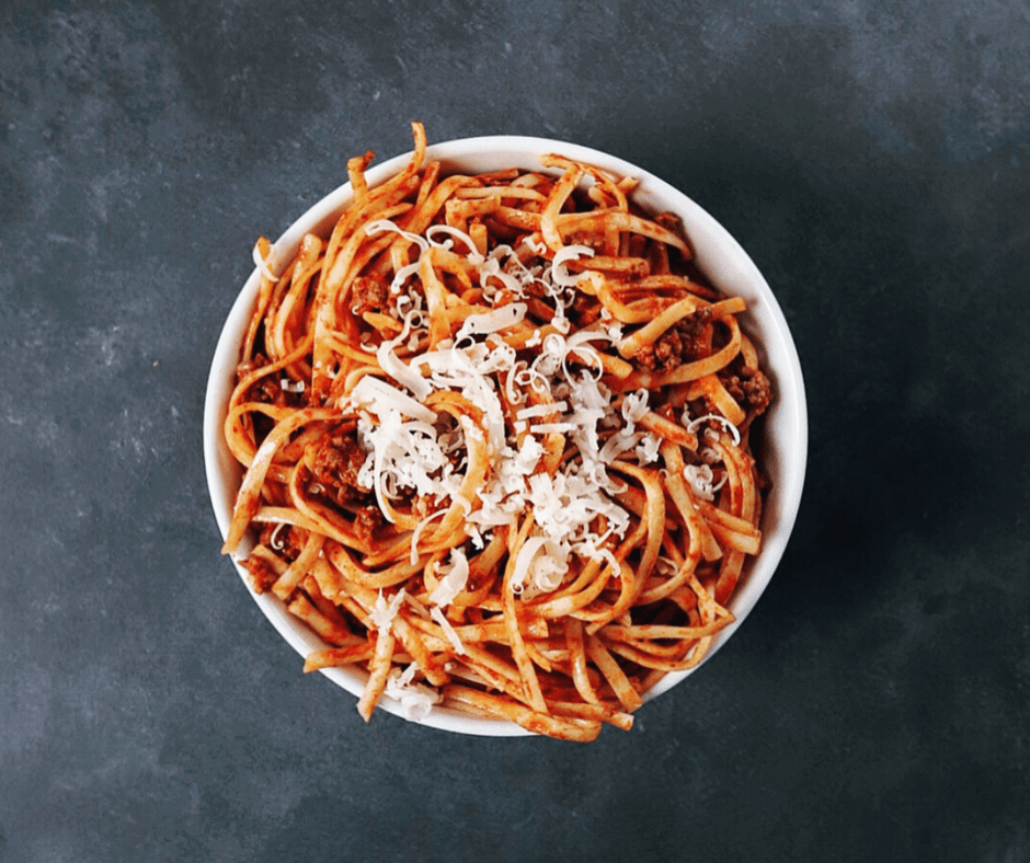 Low FODMAP spicy pasta sauce on spaghetti in bowl