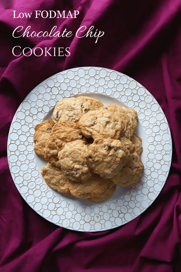 Low FODMAP Chocolate Chip Cookies sitting on decorative plate with text overlay: Low FODMAP Chocolate Chip Cookies
