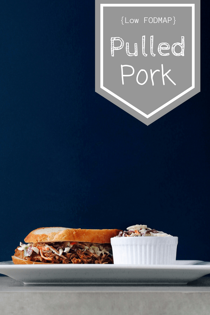 Low FODMAP Pulled Pork sandwich on plate with text overlay: Low FODMAP Pulled Pork