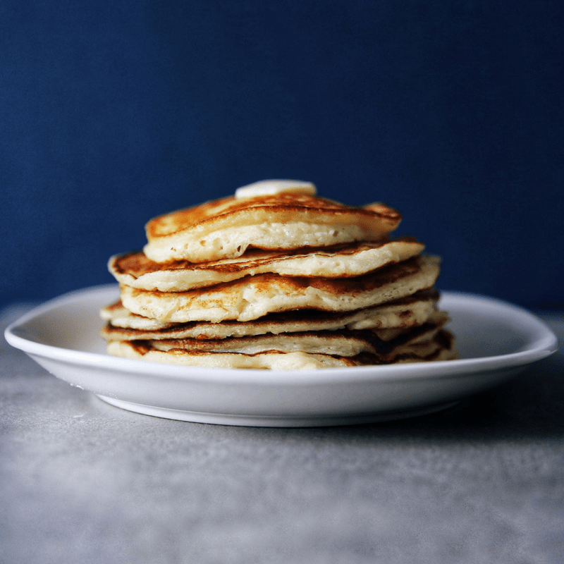 Low FODMAP pancakes stacked on a plate