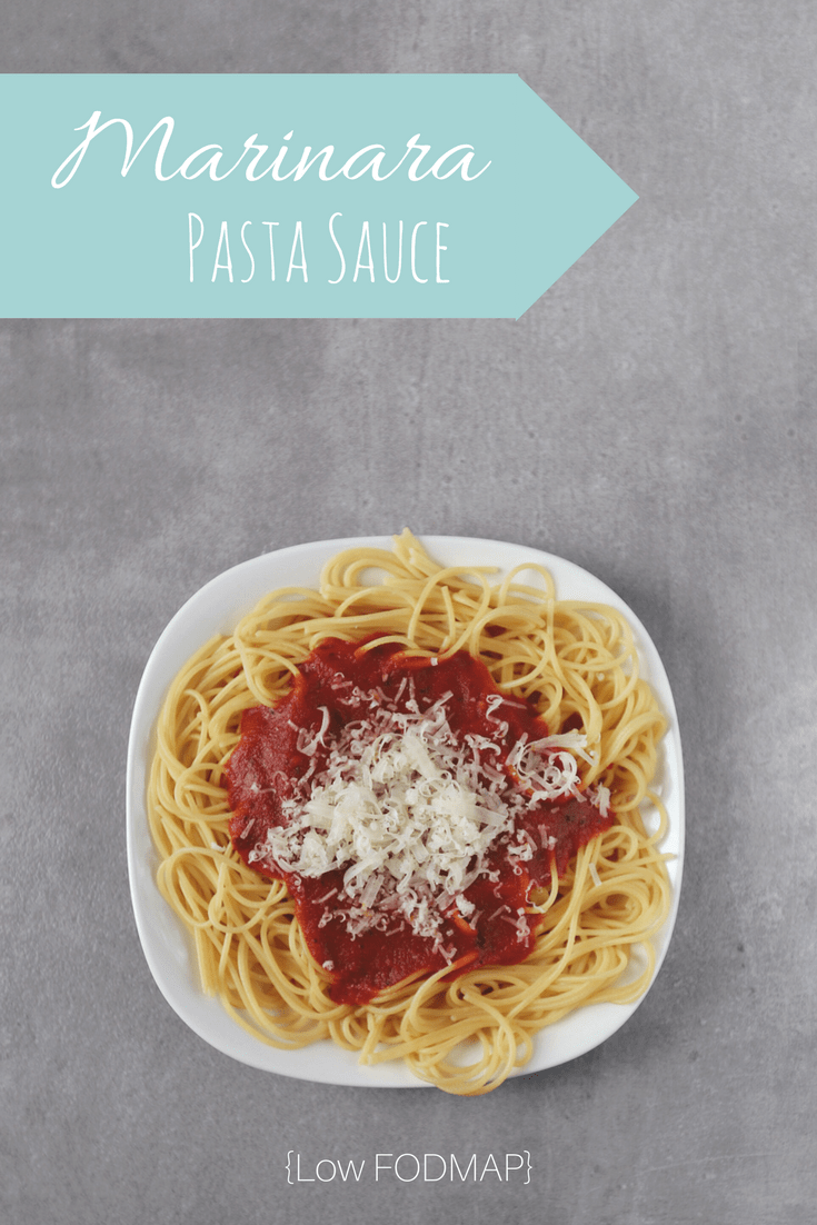 Low FODMAP Marinara Sauce with spaghetti and grated parmesan cheese on plate with text overlay: Marinara Pasta Sauce, Low FODMAP