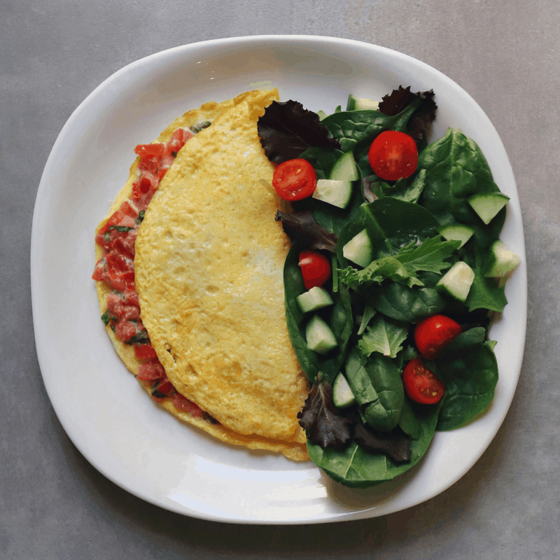 Low FODMAP Bruschetta Omelet on plate with side salad