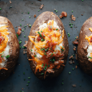 three low FODMAP twice baked potatoes on baking sheet