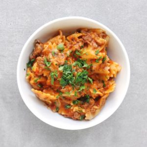 Easy Low FODMAP Lasagna in bowl with fresh parsley - Feature Image