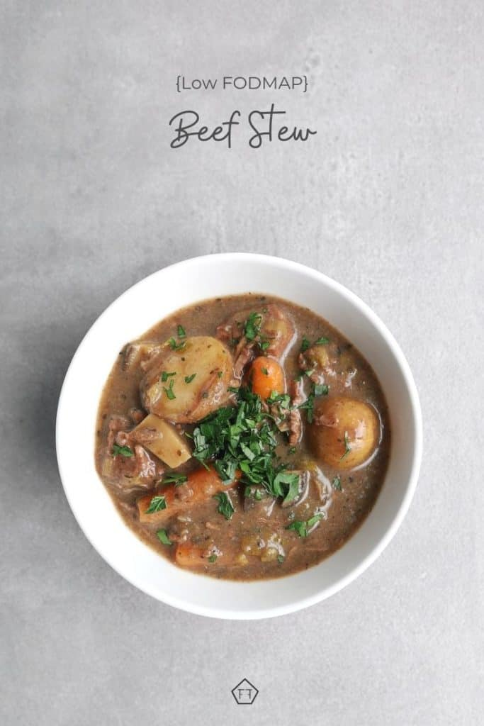 Beef stew in bowl on grey background with text overlay: low FODMAP beef stew
