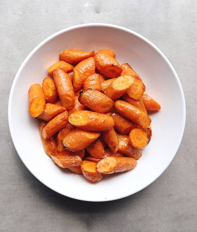 Low FODMAP brown butter carrots piled in bowl - 800 x 800