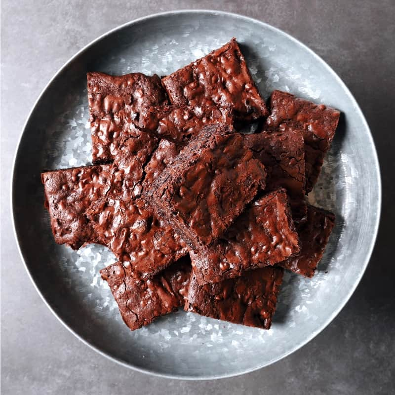 Low FODMAP brownies on metal serving dish - 800 x 800