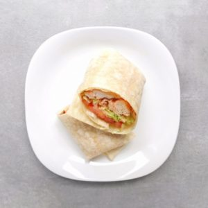 Low FODMAP Buffalo Chicken Wrap on white plate