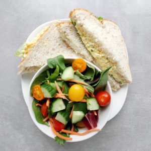 Low FODMAP Egg Salad Sandwich with garden salad - Feature Image