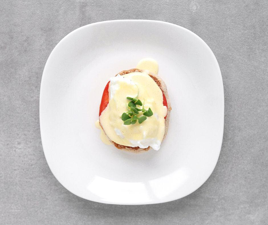 Low FODMAP Eggs Benedict on plate - 940 x 788