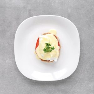 Low FODMAP Eggs Benedict on plate - Feature Image