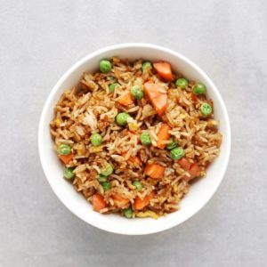 Low FODMAP fried rice with peas and carrots in bowl - Feature Image