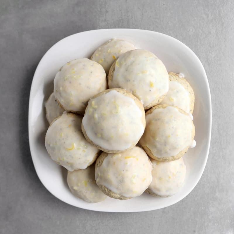 Low FODMAP lemon poppy seed cookies piled on plate - 800 x 800