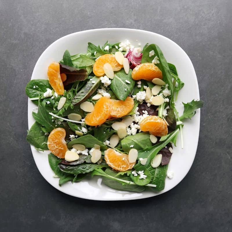 Low FODMAP mandarin orange salad with almonds on plate - 800 x 800