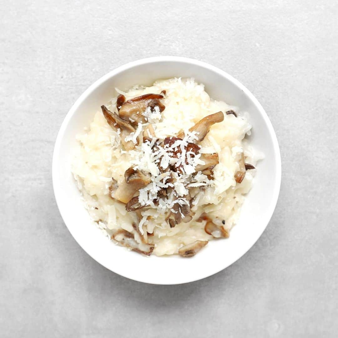 Low FODMAP mushroom risotto in white bowl