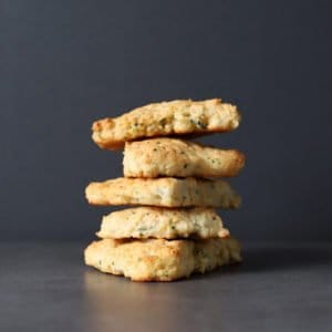 Low FODMAP Chive and Parmesan Scones Stacked on top of one another
