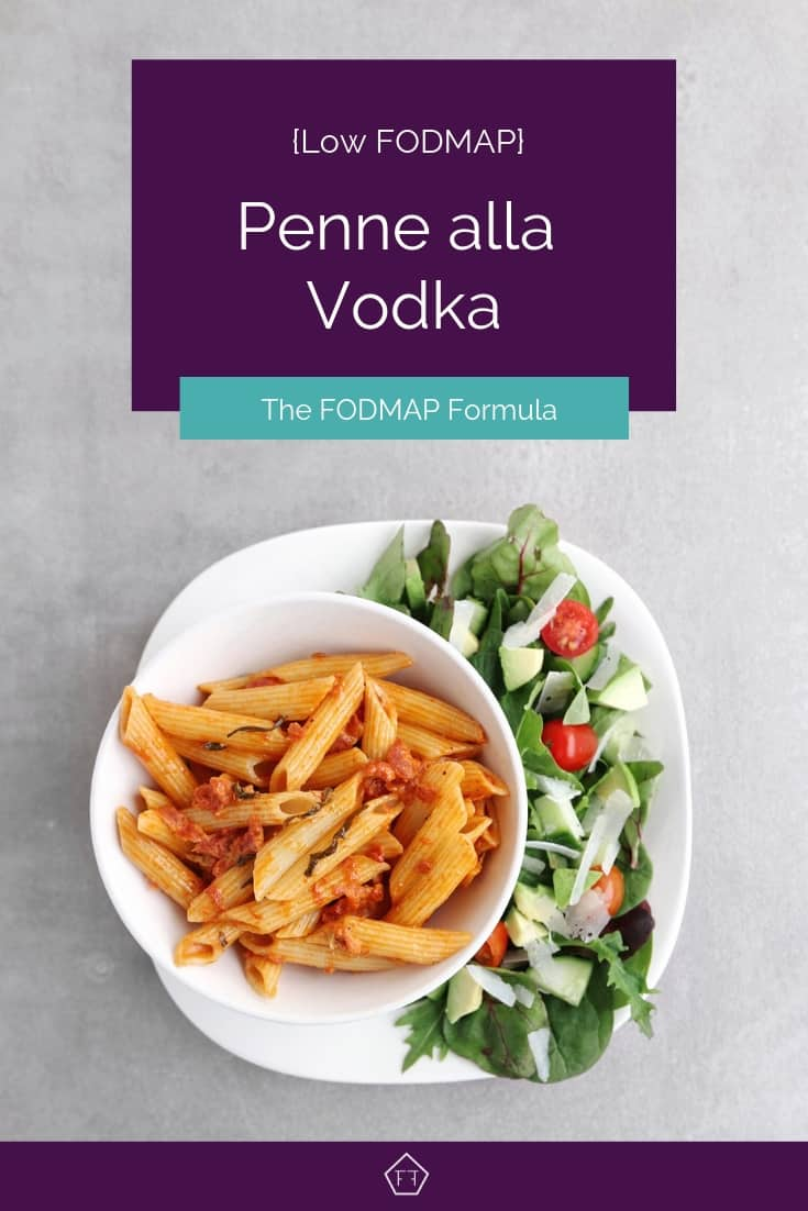 Low FODMAP penne alla vodka on plate with side salad - Pinterest 1