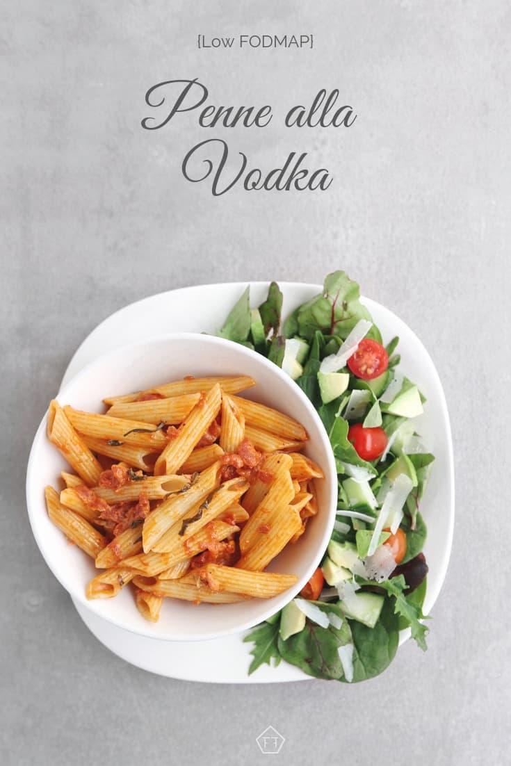 Low FODMAP penne alla vodka on plate with side salad - Pinterest 5