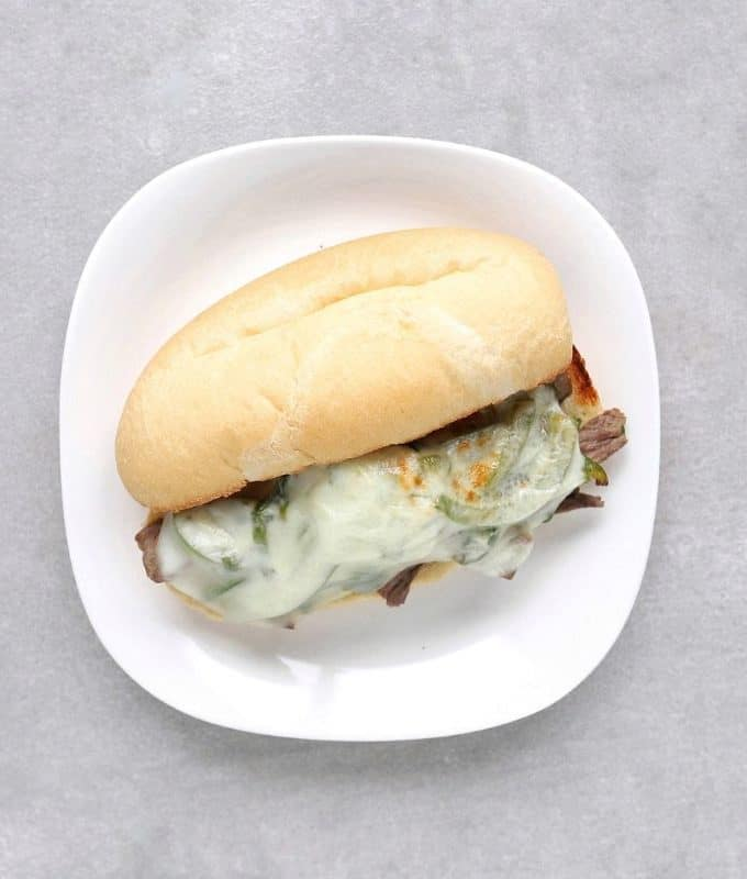 Low FODMAP Philly cheesesteak sandwich on plate - Feature Image