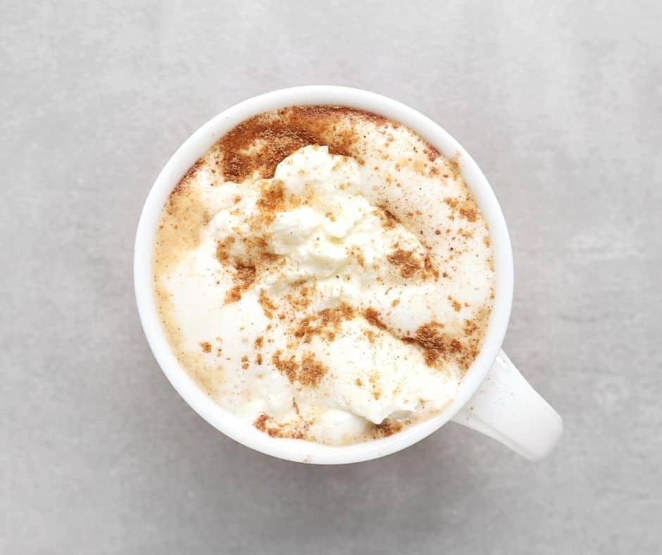 Low FODMAP pumpkin latte in white mug