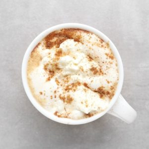 Low FODMAP pumpkin latte in white mug