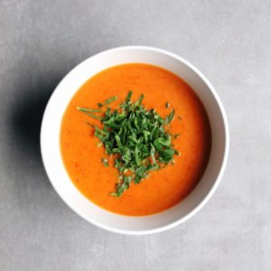 Low FODMAP Roasted Red Pepper Soup in white bowl on grey surface - 800 x 800
