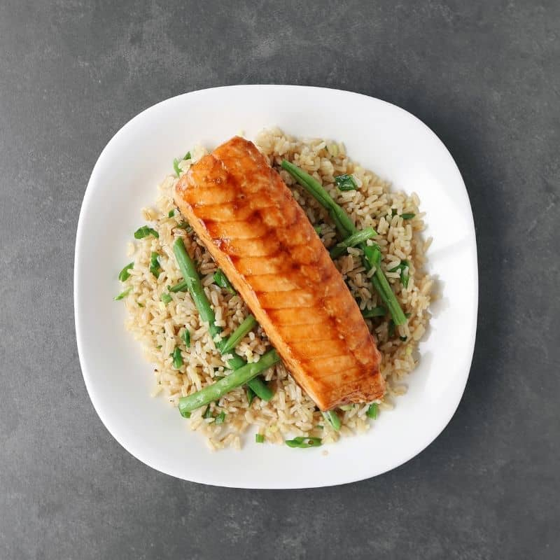 Low FODMAP soy-glazed salmon on a bed of green beans and rice - Feature Image