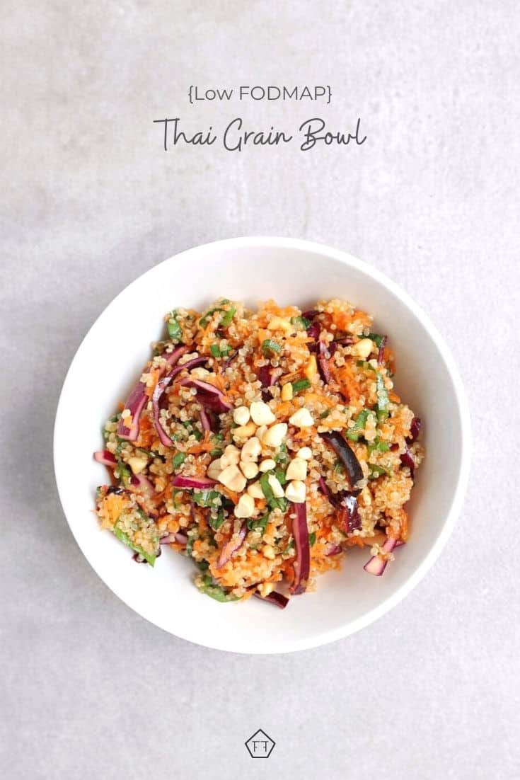 Thai grain bowl in white bowl with text overlay: Low FODMAP Thai grain bowl