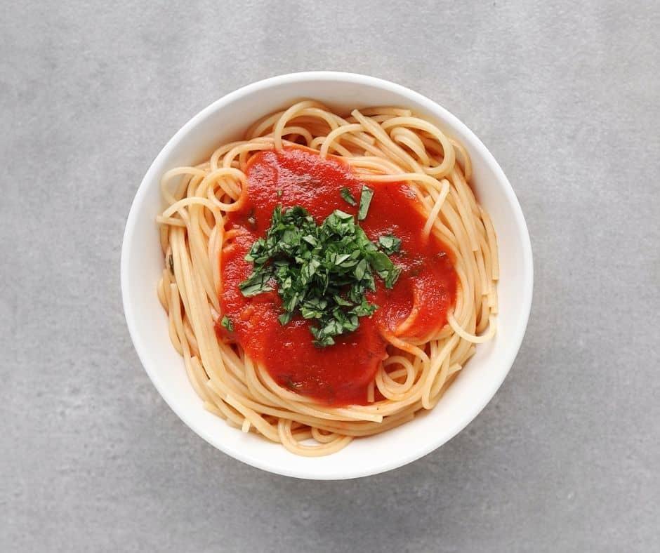 Tomato Basil Pasta Sauce on Spaghetti in bowl - 940 x 788