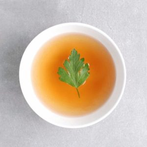 Low FODMAP vegetable broth with parsley leaf