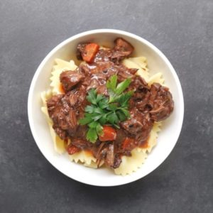 Low FODMAP beef bourguignon in white bowl