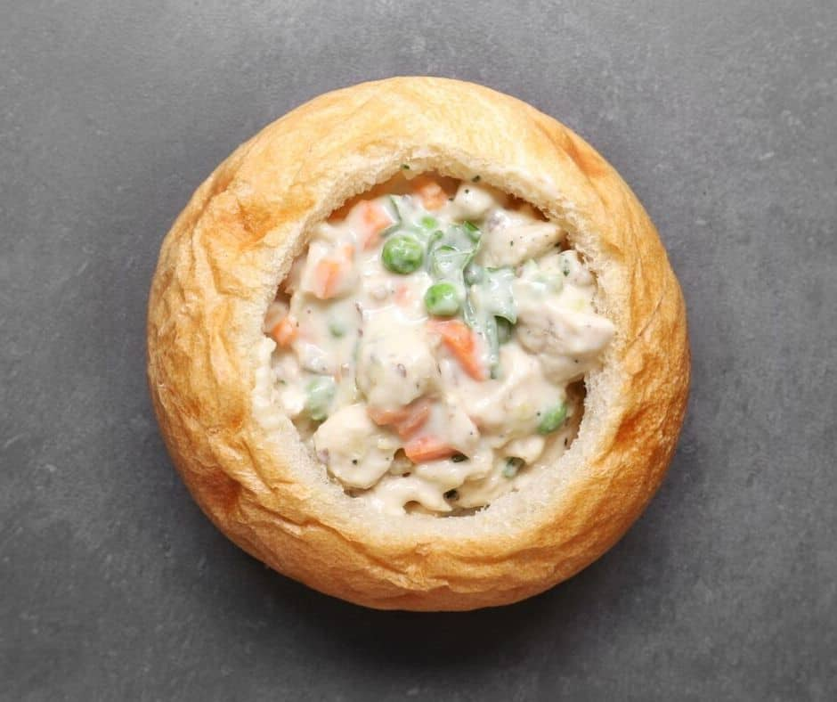 Low FODMAP chicken pot pie in bread bowl
