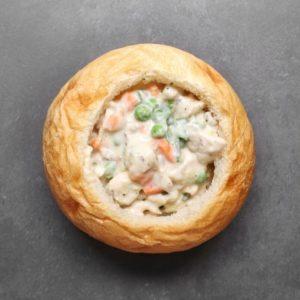 Low FODMAP chicken pot pie in bread bowl