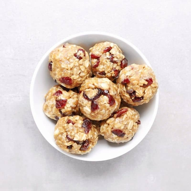 Low FODMAP cranberry white chocolate protein balls in white bowl