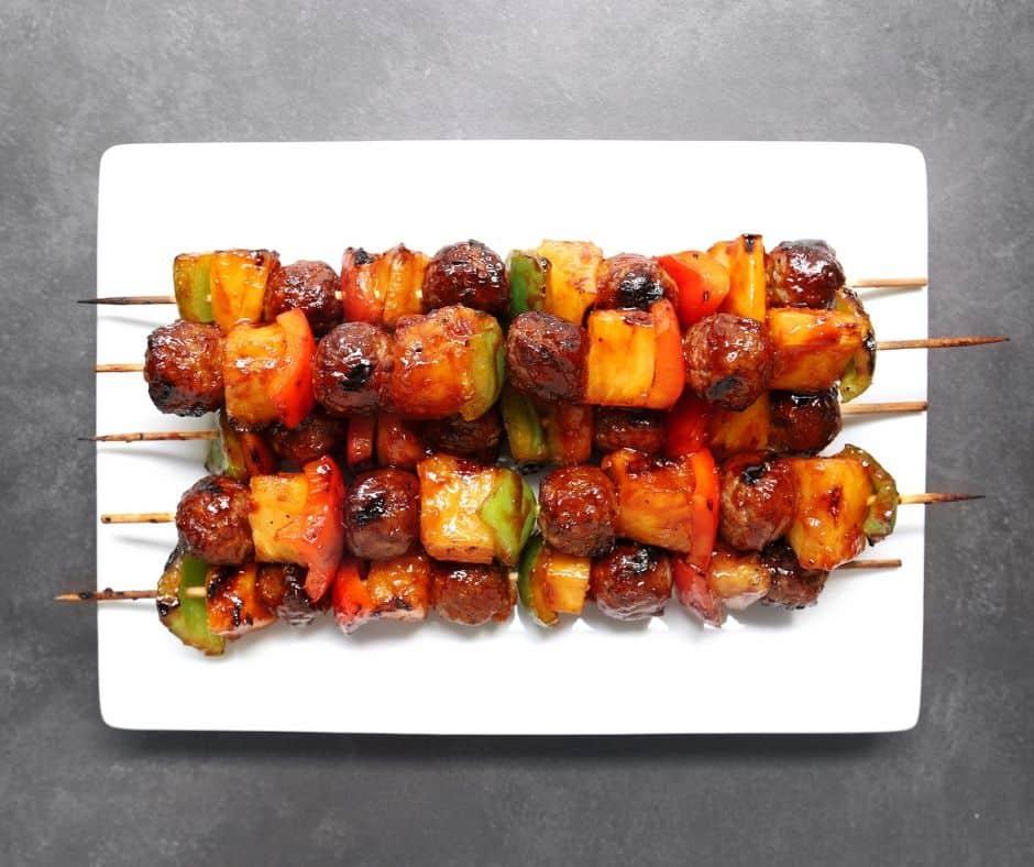Low FODMAP meatball kebabs piled on plate