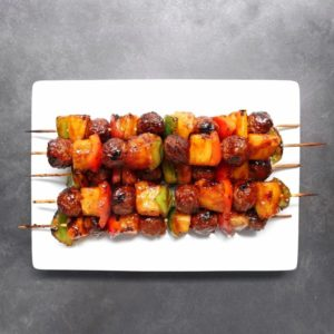 Low FODMAP meatball kebabs piled on plate